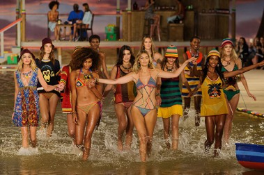 Gig Hadid leading the other models through the water at Tommy Hilfiger.